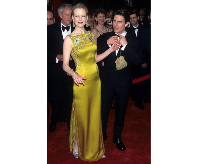 "Here she and her then-husband Tom Cruise arrive at the 69th Annual Academy Awards in 1997. Nicole wore John Galliano for Christian Dior and has appeared on best ""Oscar dresses ever"" lists ever since."