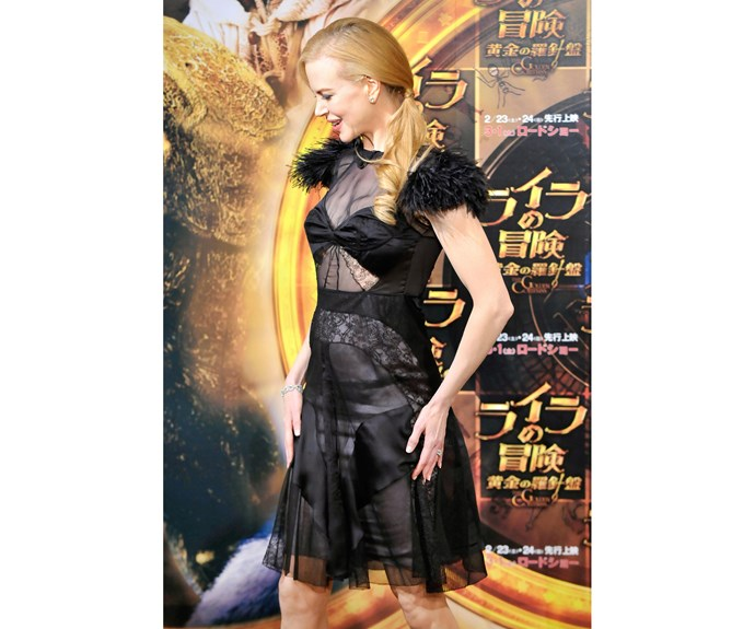 Nicole looked almost as impressed by her dress at the Tokyo screening of the *The Golden Compass* as we were.