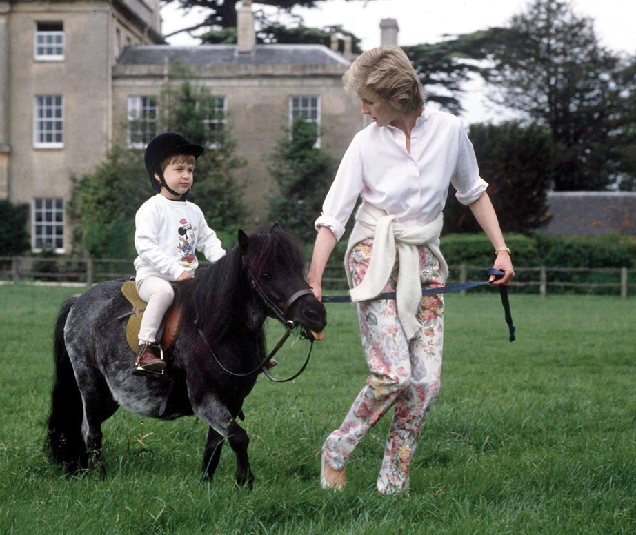 The Prince's love for polo began from a young age - here he's pictured riding his miniature pony Smoky, at his Highgrove home with Princess Diana in 1985. <br><br> *(Image: Getty)*