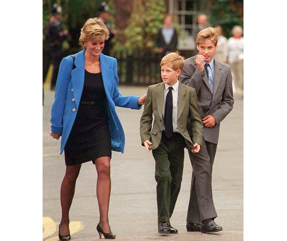 The royal brothers with their mother the late Princess Diana on Harry's first day at Eton in 1995. *(Image: Getty)*