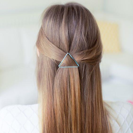 **Triangle pins** We love this super simple triangle style created using just three bobby pins. Use pins that contrast with your hair colour for a style that pops. [Via Luxy Hair Blog](https://nz.pinterest.com/pin/444589794442004433/)