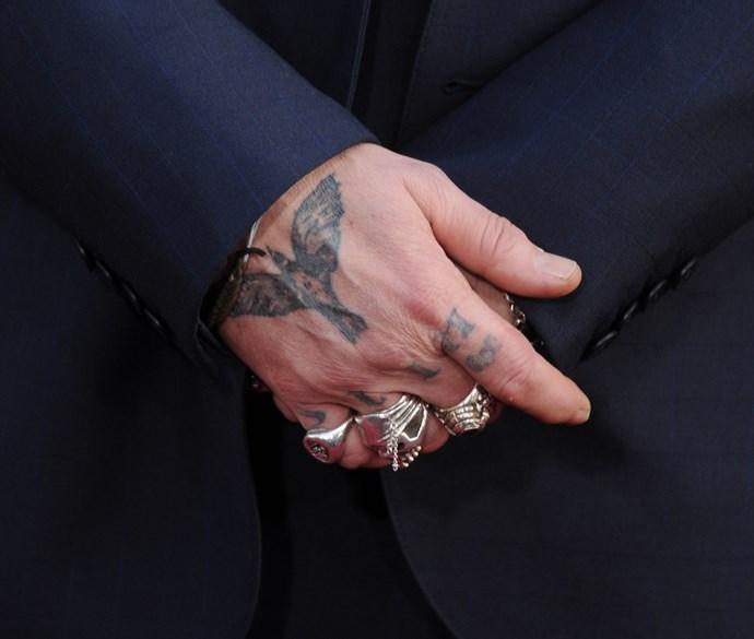 Depp originally had 'slim' tattooed on his knuckle