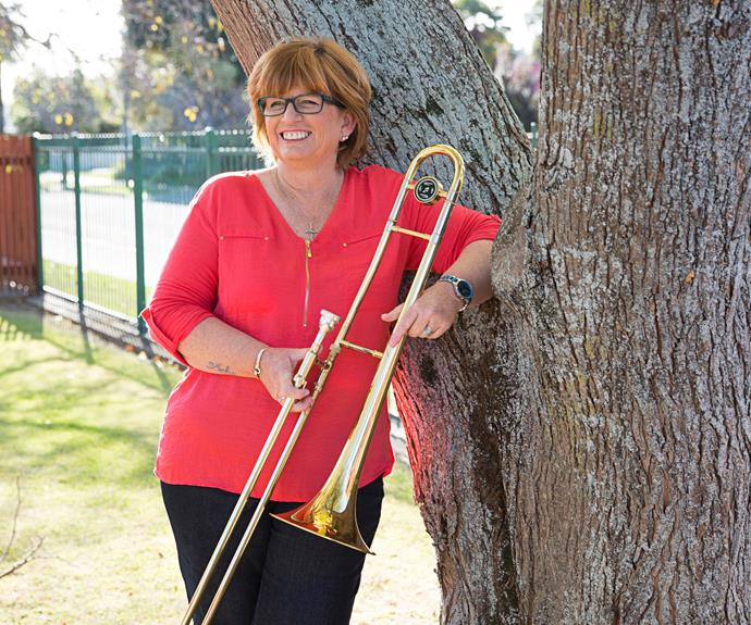 Outside of work, her passion is playing the trombone.