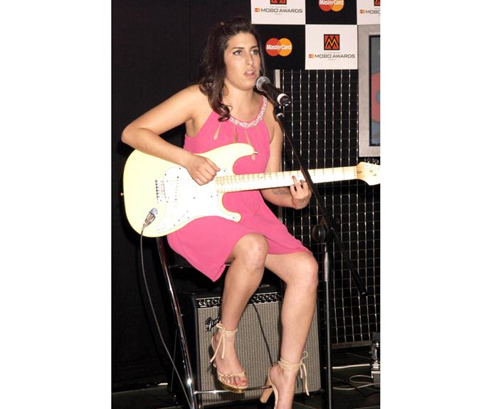 Before her fame and her signature beehive hairstyle, Amy sang in bars. Here she is as a supporting act at the Mobo Awards Nominations 2003, at Tantra Nightclub In Kingley Street In Soho, London. The next year, *Frank* would be released and fame would begin to creep up on her.