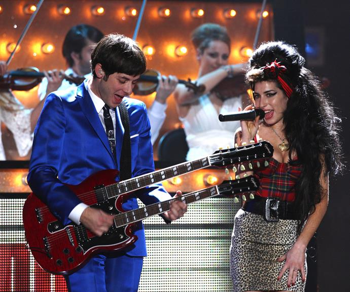 Amy Winehouse and her producer Mark Ronson looked ecstatic to be performing on stage at the Brit Awards 2008 in London, with Mark playing a twin necked guitar.