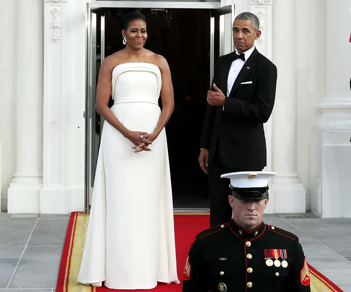Barack gives his wife's outfit a thumbs up while the pair wait at the White House for the arrival of Prime Minister Lee Hsien Loong of Singapore and his wife Ho Ching.