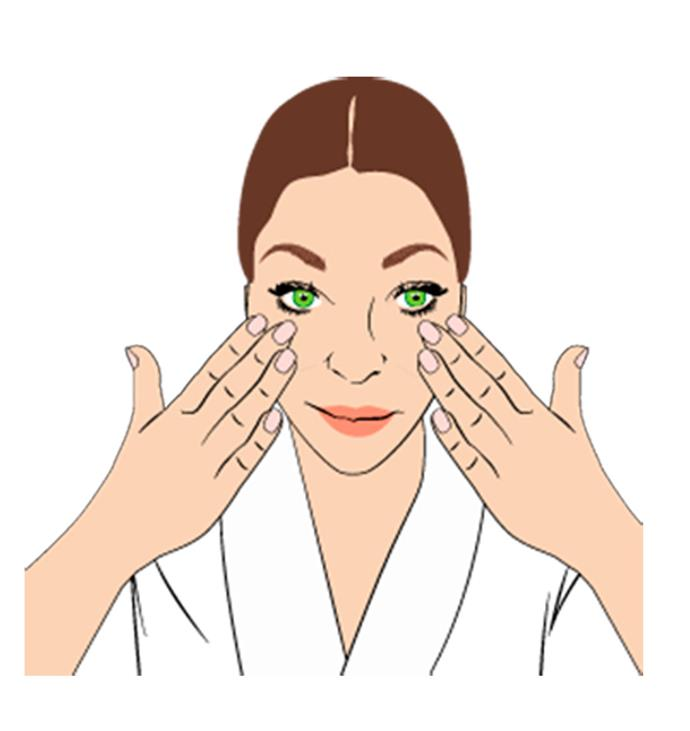 """**Step 2**  Place your hands on your cheeks and gently sweep up and out. """"Use smooth, gentle motions. Start in the centre and work outward to boost hydration and help lymphatic drainage,"""" explains Nichola. """"Then tap your fingertips across your face in small, circular movements for a minute."""""""