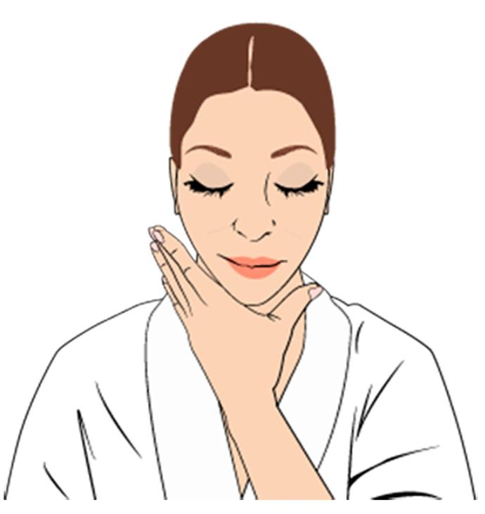 """**Step 5**  To boost firmness in the delicate neck area, use the heel of your palms to lightly massage oil in. """"Use upward sweeping motions with gentle pressure,"""" says Nichola."""