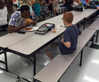 Football player befriends autistic boy