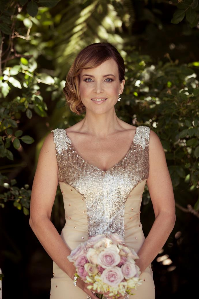 In her wedding dress for Rachel's marriage to Chris.