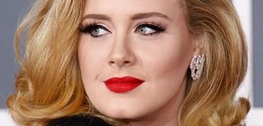 Adele reveals battle with postnatal depression