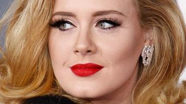 Adele reveals battle with postnatal depression