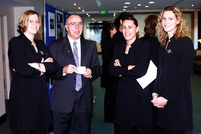 Developing a strong flair for netball during her youth, by her early 20s Jenny May had a spot in the national team the Silver Ferns. Here she is pictured in the 90s with Ferns teammates and the New Zealand High Commissioner Simon Murdoch.