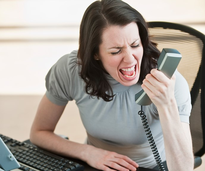 A woman on the phone reporting mansplaining
