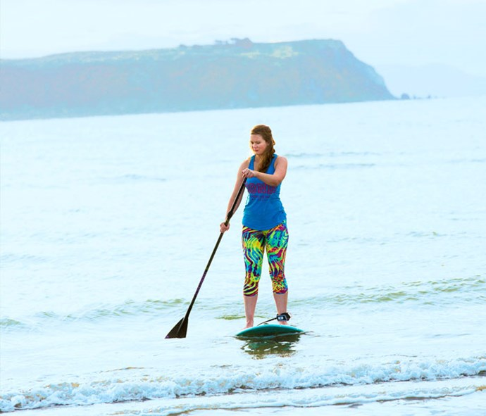 The keen paddle-boarder tries to get out on the water at least once a week over summer.