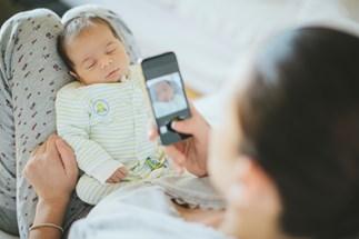 mum taking photo of baby