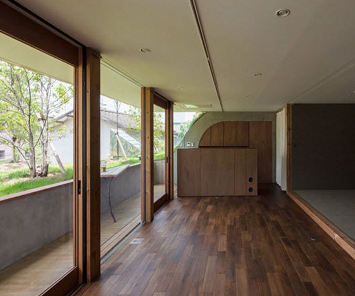 Rough-looking dark timber floors add to the environment's natural aesthetic. Photo: Courtesy of Keita Nagata Architectural Element