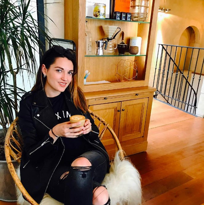 Amber Vito celebrates finally getting a good coffee in France.