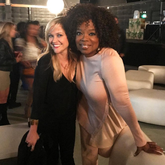 Reese Witherspoon celebrates wrapping *A Wrinkle in Time* with Oprah.
