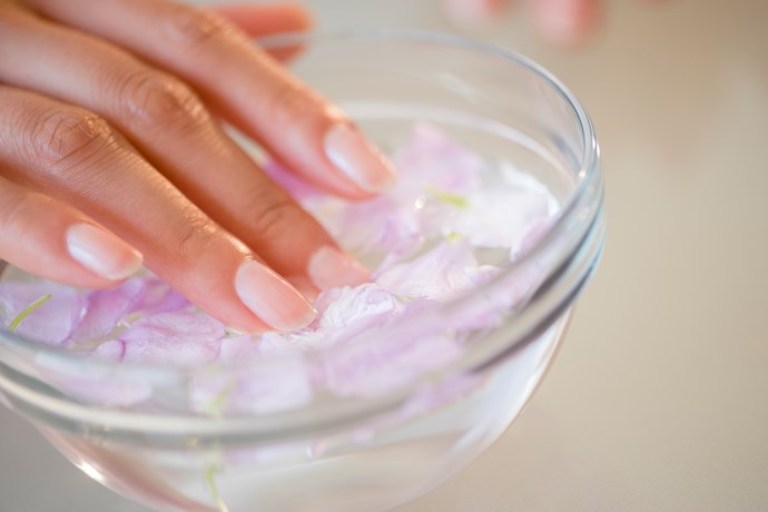 "For a perfect manicure, ensure you start with a totally clean nail. Even if you aren't wearing polish, wipe nail polish remover over the surface of the nail to make a smooth, oil-free surface. Apply two even coats of polish, being sure to ""cap"" the nail's free edge by removing most of the polish from the brush and swiping onto the tip. Finish with a gel clear top coat. **Madeline Poole, Sally Hansen nails global ambassador.**"