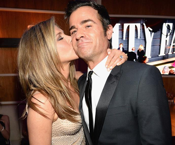 Jennifer Aniston, who was clearly having the most fun out of anyone, plants a kiss on her beau Justin Theroux!