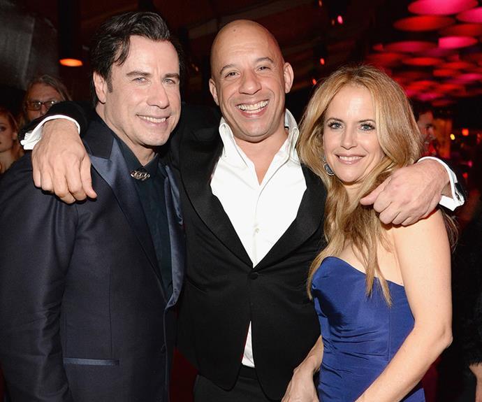 Vin Diesel cuddles up to John Travolta and Kelly Preston!