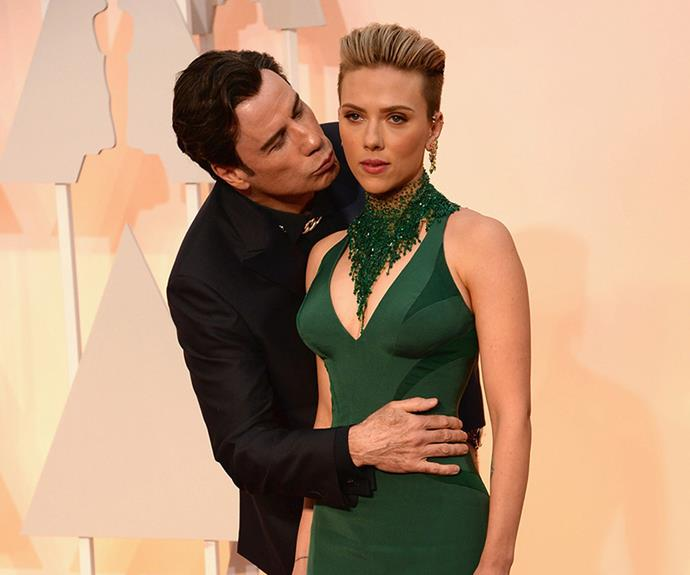 Earlier in the moment he had another rather disconcerting moment on the red carpet, when he leaned in for a kiss with actress Scarlett Johansson which lead to this very awkward photo.
