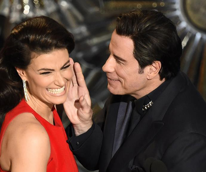 """The moment came after Idina introduced John to the stage as """"Glom Gazino"""" as payback for his infamous mispronunciation of her name as """"Adele Dazeem"""" at last year's Oscars. It was his chance to redeem himself by poking fun at himself but instead the face-touching just led to quite an awkward moment for all those watching."""
