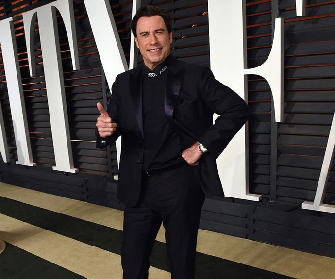 John Travolta had a few awkward moments at this year's Oscars - not least this rather stiff thumbs up at the Vanity Fair after-party.