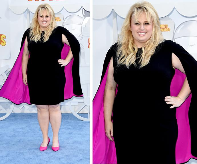 Rebel Wilson channels her inner super hero in this gorgeous caped gown!