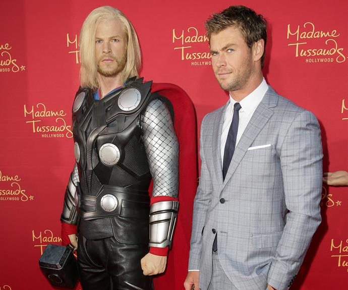 Chris Hemsworth doesn't looked convinced with his wax *Thor* replica. Is it the tiny head or platinum blonde Barbie wig that's throwing you, buddy?