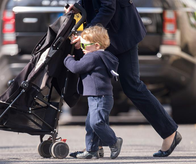 The 21-month-old future king rugged up in a navy hooded jumper and matching trousers.