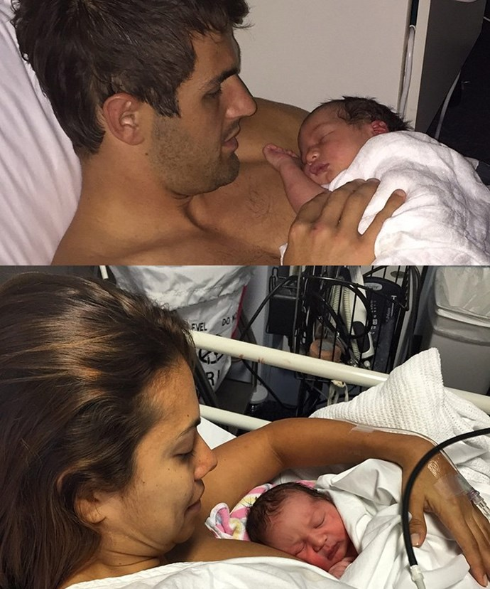 Josh and Ana cradle their healthy baby son, Emilio.