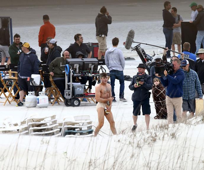 Movie magic: protected by just a pair of skintight nude undies and a soft toy, Zac braced himself against the cold weather and stepped out in front of a full film crew.