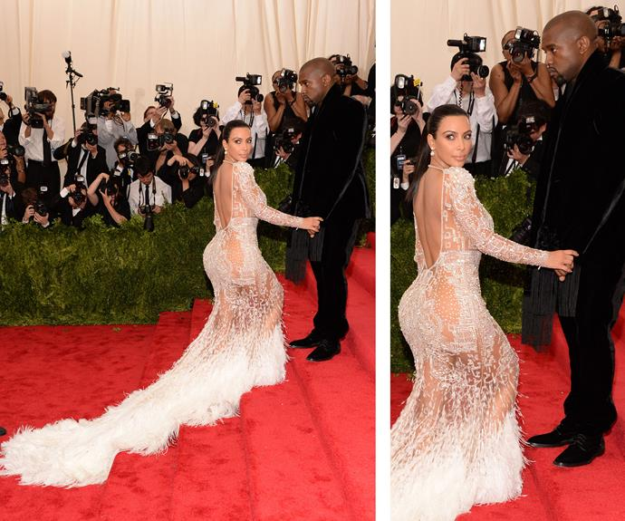 Kim Kardashian shows off her booty in a rather sheer gown