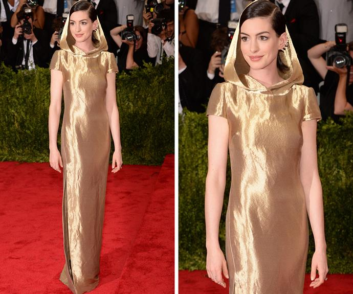 Anne Hathaway went for a slinky hooded gown