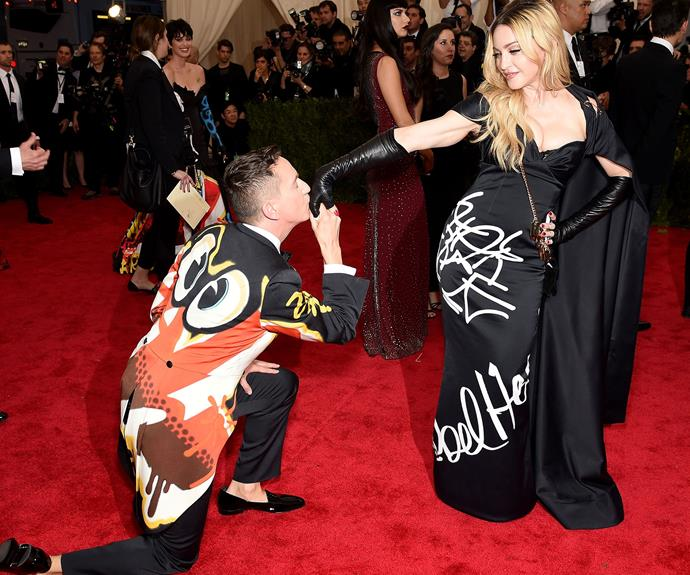 Madonna gets a kiss on the hand from designer Jeremy Scott