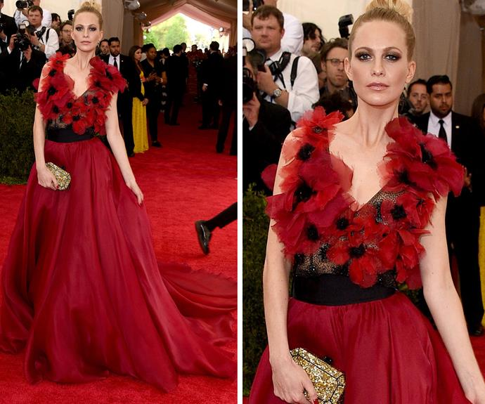 Poppy Delevingne wearing a gown adorned with her namesake flowers!