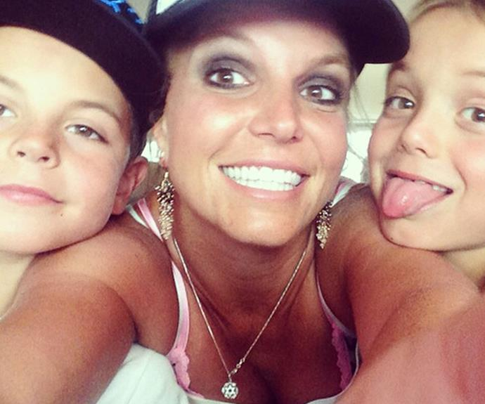 "Britney Spears with her boys, Jayden and Sean. Keeping it real, the popstar admitted she sometimes feels like a ""dull and invisible mum."""