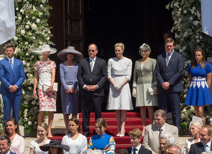 Mr Gareth Wittstock et Mrs Nerine Pienaar, Princess Caroline of Hanover, Prince Albert II of Monaco and Princess Charlene of Monaco, and Princess Gabriella of Monaco, Diane de Polignac Nigra and M. Christopher Le Vine Jr show Prince Jacques of Monaco to the people during the baptism of the Princely Children at Monaco Cathedral on on May 10, 2015 in Monaco, Monaco. (Photo by Didier Baverel/WireImage)