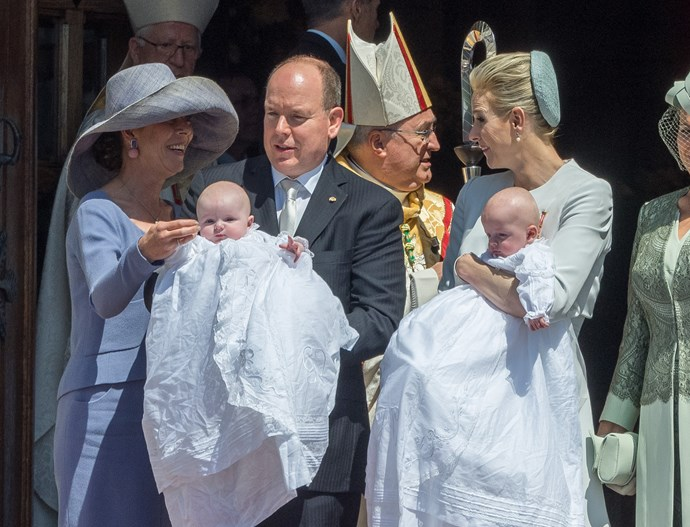 Prince Albert II of Monaco and Princess Charlene of Monaco show Prince Jacques of Monaco and Princess Gabriella of Monaco with Princess Caroline of Hanover (L) and Diane de Polignac Nigra (R) to the people during the baptism of the Princely Children at the Monaco cathedralon on May 10, 2015 in Monaco, Monaco. (Photo by Didier Baverel/WireImage)