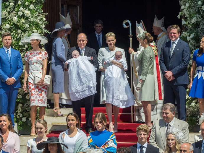 Mr Gareth Wittstock et Mrs Nerine Pienaar, Princess Caroline of Hanover, Prince Albert II of Monaco, Princess Charlene of Monaco, Diane de Polignac Nigra and M. Christopher Le Vine Jr show Princess Gabriella of Monaco and Prince Jacques of Monaco to the people during the baptism of the Princely Children at the Monaco cathedralon on May 10, 2015 in Monaco, Monaco. (Photo by Didier Baverel/WireImage)