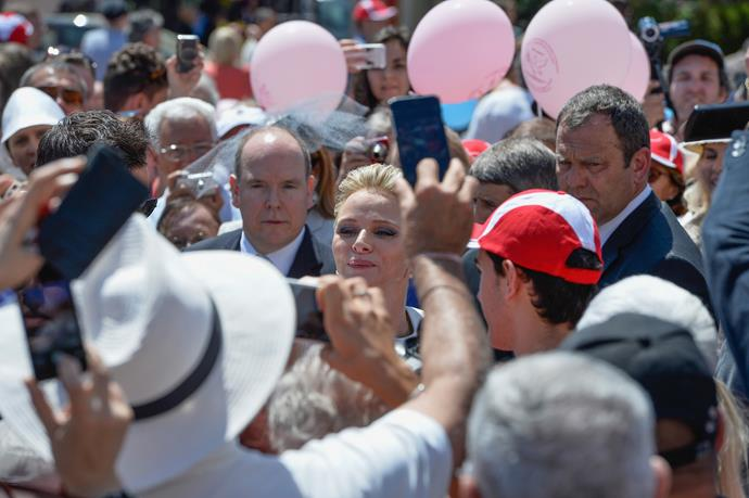 Prince Albert of Monaco and Princess Charlene of Monaco walk on the Palace square after the Baptism of their twins at Monaco Cathedral on May 10, 2015 in Monaco, Monaco. (Photo by Didier Baverel/WireImage)