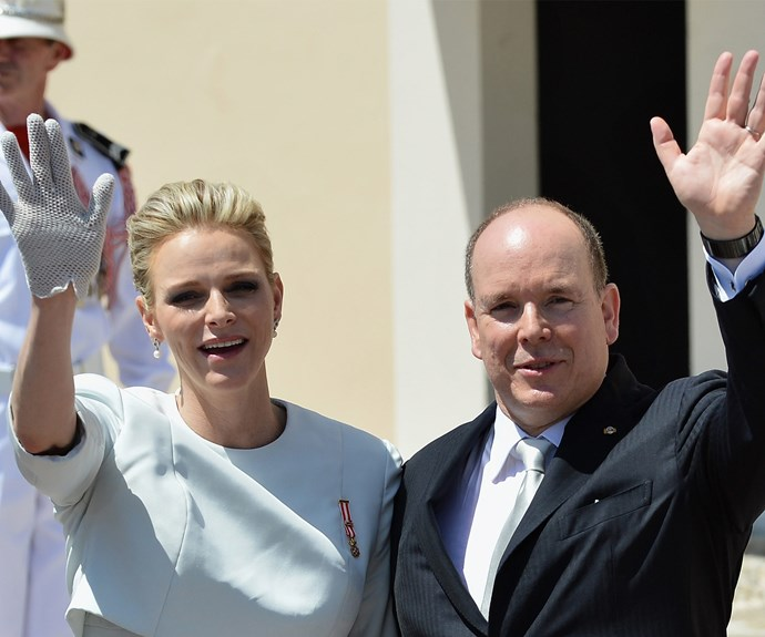 The married royals wave to well-wishers.