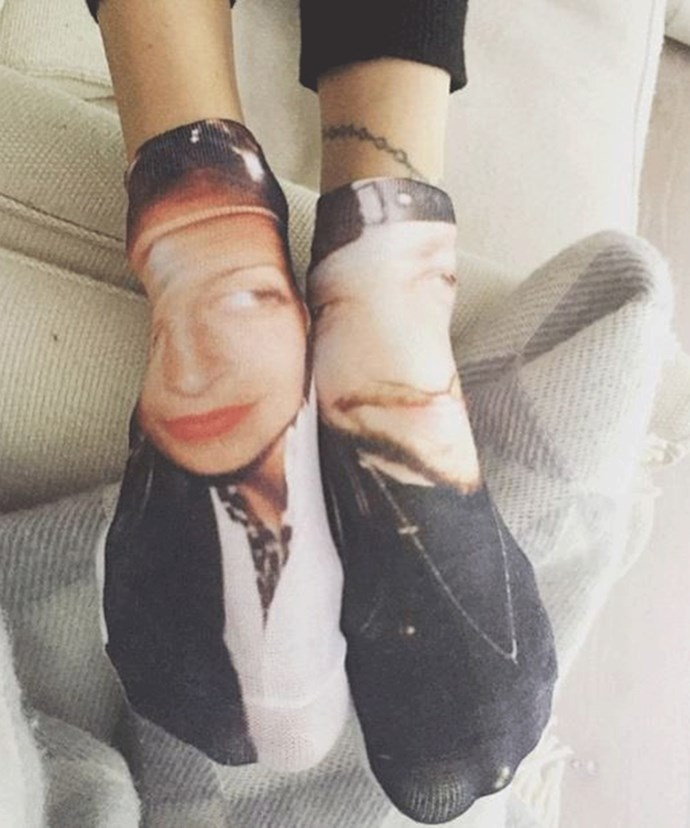 In true Hollywood fashion, the couple have socks with their faces printed on them!