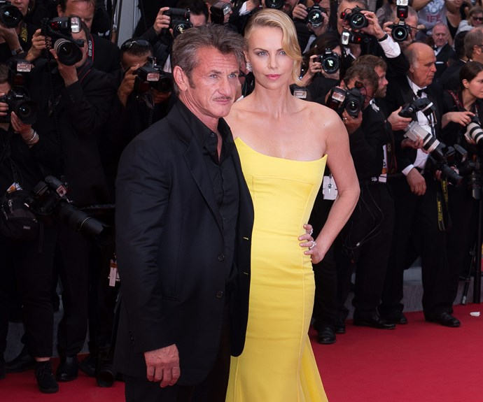 Could we take a moment for Charlize Theron and her beau, Sean Penn! They are channeling all kinds of old school glamour!