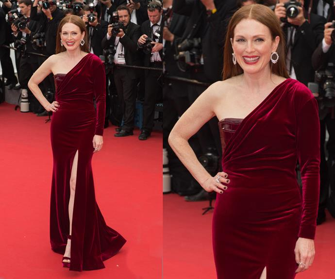 Lady in red! We'd be smiling too! Oscar-winner Julianne Moore is a vision in red velvet! Simply delicious!