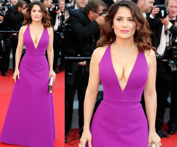 Salma Hayek could ooze sex appeal in a potato sack, but make no mistake this is not that! The hot mama wowed in this stunning fuchsia dress, showing off her famous cleavage and that itty-bitty waist!