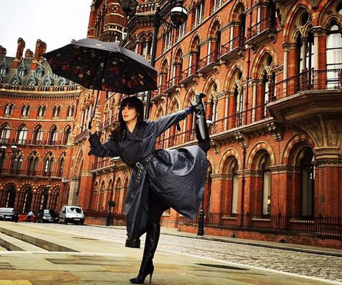 Hilaria Baldwin didn't let the rainy London weather deter her from striking a pose outside the St Pancras Hotel in Kings Cross.