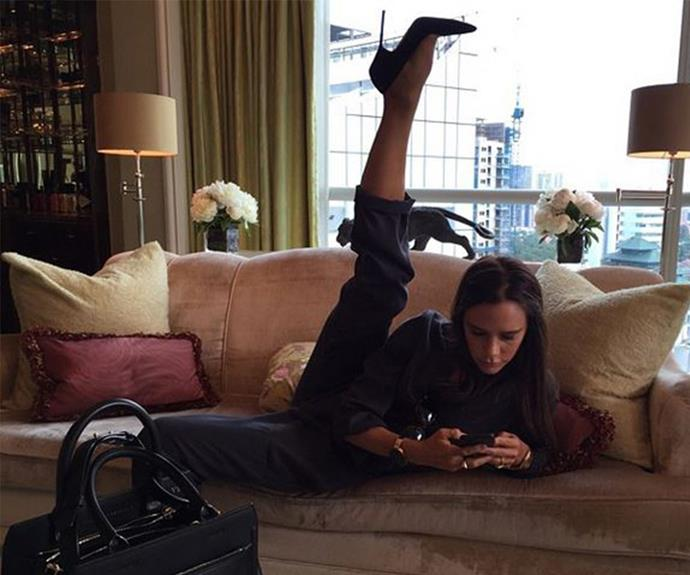 During her business trip to Singapore Victoria Beckham multi-tasked by firing off some emails as she kicked up her leg to impressive heights. Just another day in the life, really.